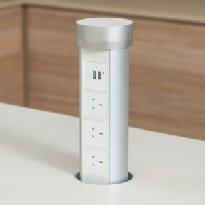 Silver Point Pod Multi in Silver installed in white kitchen bench. 3 GPOs and 2 USB chargers.
